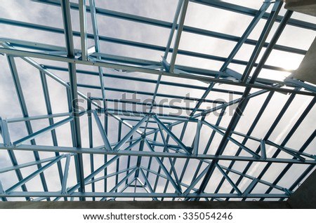 Structure of steel roof frame for construction.In Prefabricated House system. - stock photo