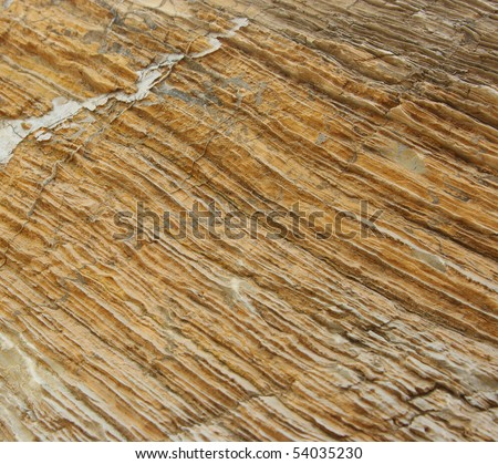 Structured texture of brown stone, similar to wood