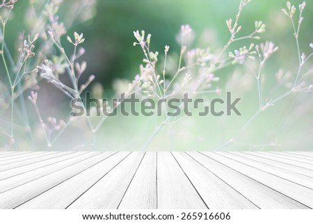 Structures of flowering grass soft blur And wood floors - stock photo