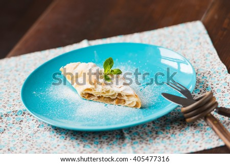 strudel on kitchen table. Natural day light - stock photo