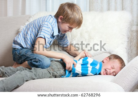 Struggle between two brothers, indoor. - stock photo