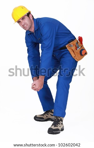 Struggling manual worker - stock photo