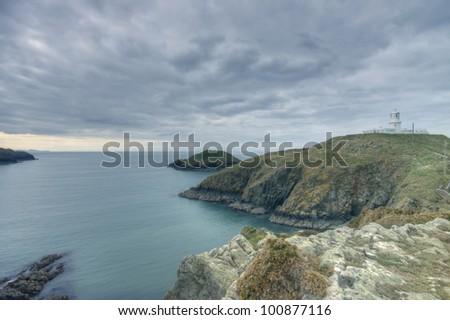 Strumble Head Lighthouse on the Pembrokeshire Coast - stock photo