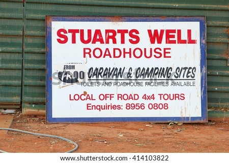 STUARTS WELL / ALICE SPRINGS, AUSTRALIA - December 5. Signboard of Stuarts Well Roadhouse and camping sites in the Australian Outback on December 5, 2015 in Stuarts Well / Alice Springs.