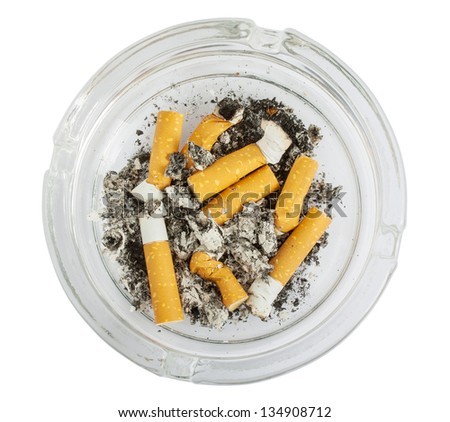 Stubs in glass ashtray isolated on white background - stock photo