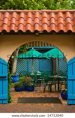 Stucco, spanish tile, blue gates in a small patio courtyard in Santa Fe