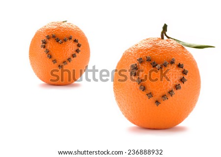 Studded oranges - stock photo