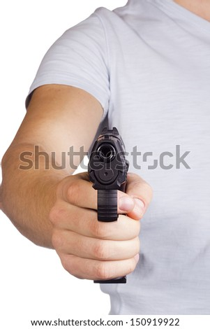 Student aims a gun. Availability of guns to young people. - stock photo