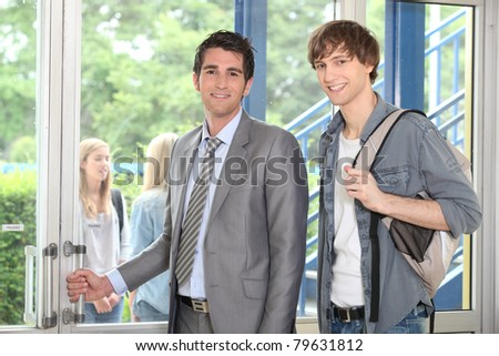 Student and lecturer at the entrance - stock photo