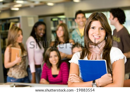 student and teacher looking smiling at the library - stock photo