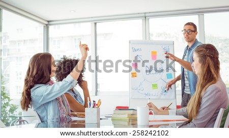 Student asking a question during a presentation at the college - stock photo