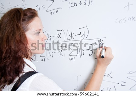 Student at blackboard in classroom