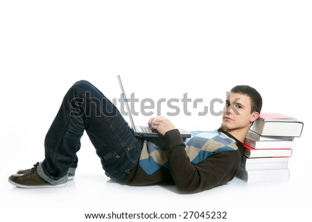 Student boy lying on floor, books and laptop computer isolated on white