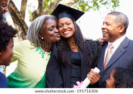 Student Celebrates Graduation With Parents - stock photo