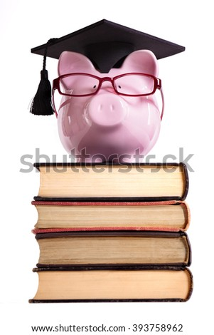 Student college graduation piggybank isolated on white background, front view, vertical - stock photo