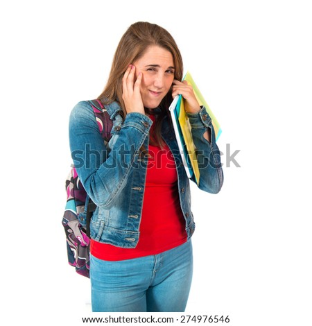 Student covering her ears over white background - stock photo