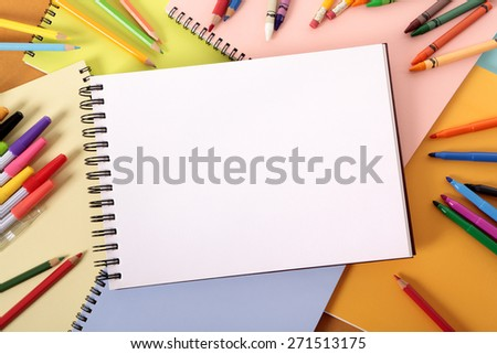 https://thumb9.shutterstock.com/display_pic_with_logo/87057/271513175/stock-photo-student-desk-art-sketch-book-pencils-crayons-top-view-271513175.jpg