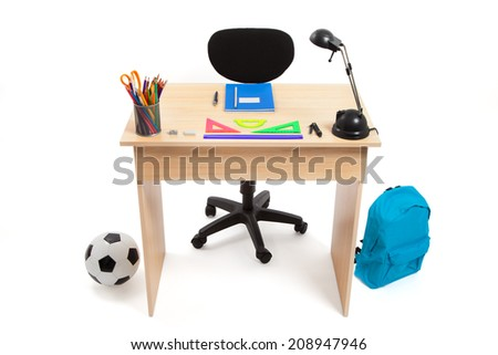 Student desk with school supplies isolated on white - stock photo