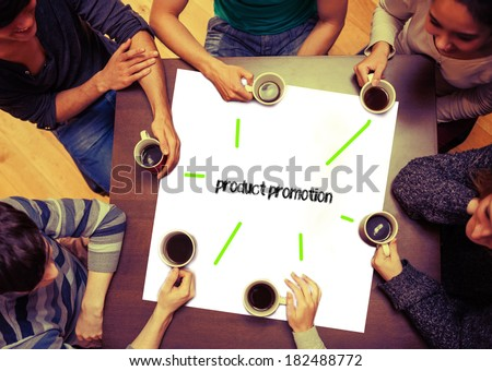 Student drinking coffee sitting around page saying the word product promotion