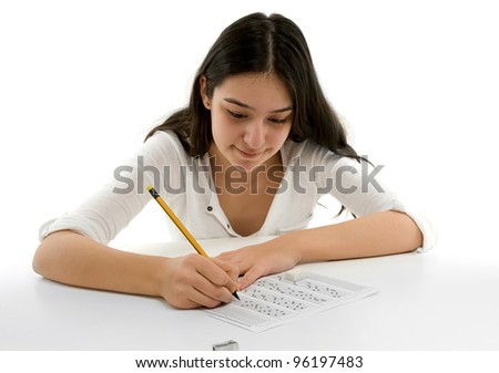 Student filling out answers to a test with a pencil.