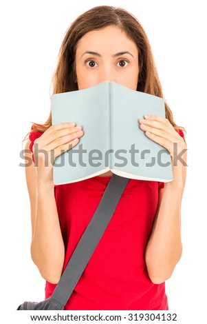 Student girl behind her book