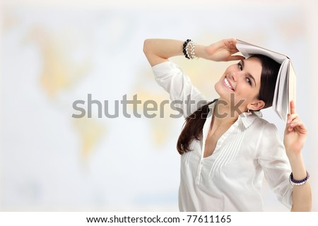student girl cheerful with books over world map background