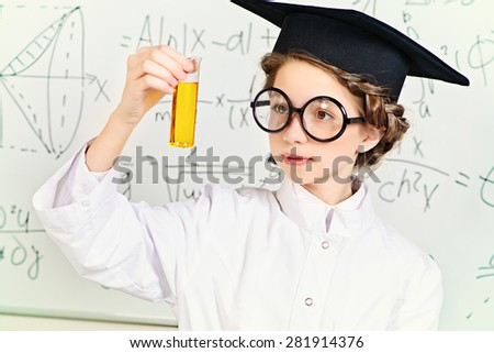 Student girl doing research in the laboratory. Science and education.  - stock photo