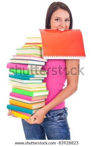 student girl holding lot of books in hands and one in the teeth