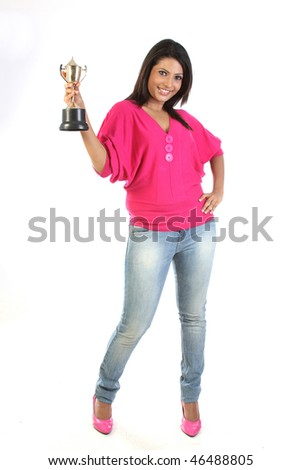 student girl holding the winning gold trophy - stock photo