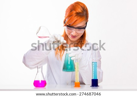 Student girl in the lab doing chemistry reactions - studio shoot  - stock photo