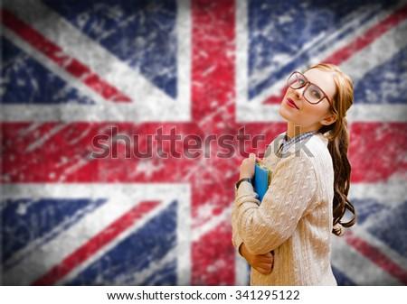 Student girl on english union jack blurred background - stock photo