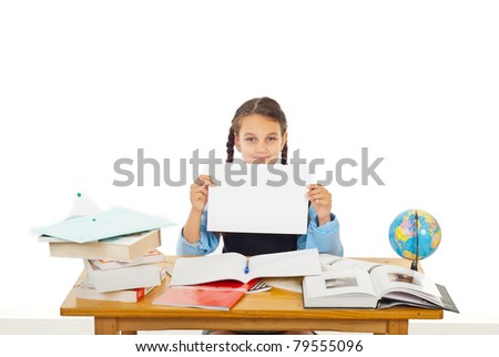 Student girl sitting at pupil with books showing black white paper isolated on white background