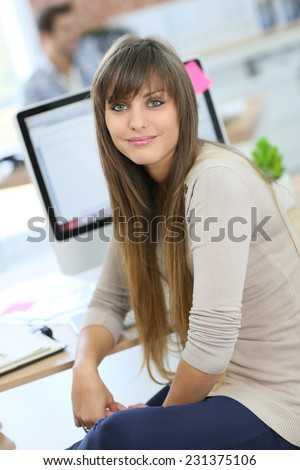 Student girl sitting in front of desktop computer
