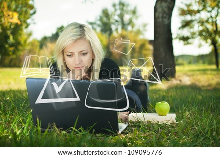 student girl studying in park with laptop - stock photo