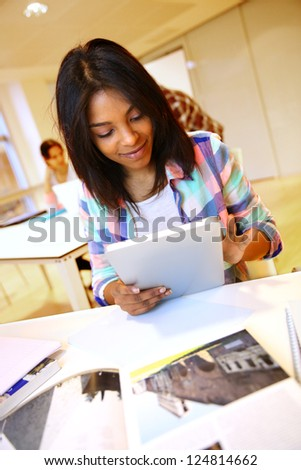 Student girl using electronic tablet at school - stock photo
