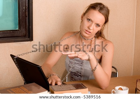 Student girl with books, chain and laptop in her room - stock photo