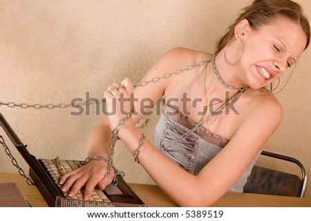 Student girl with laptop and chain in her room - stock photo