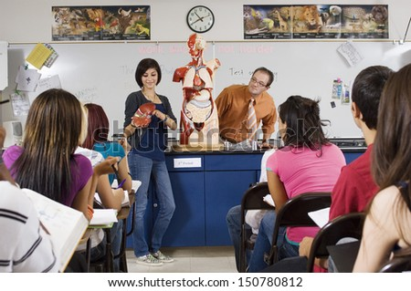 Student Giving Presentation in Science Class - stock photo