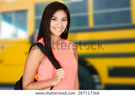 Student going to class at her high school - stock photo