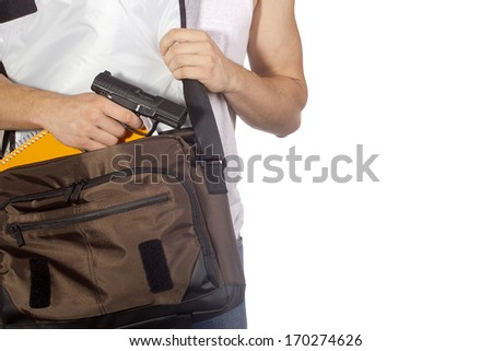 Student hides gun in a bag. Crime. - stock photo