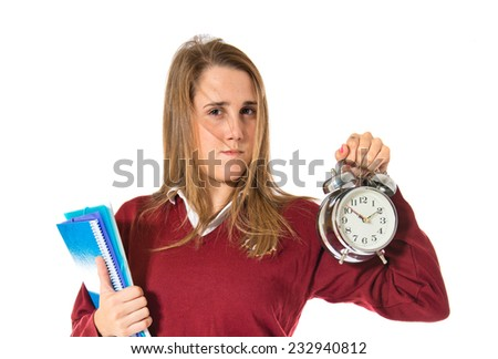 Student holding a clock over white background   - stock photo