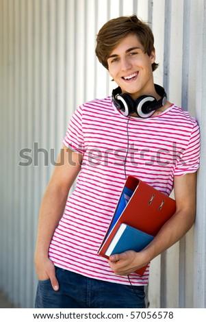 Student holding books - stock photo