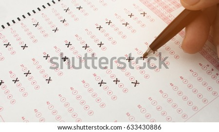 student holding pen for testing in exercise, exams answer sheets and checkbox for final exams test in school