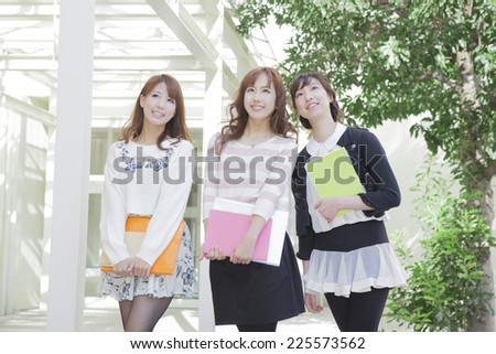 Student holding the notebook - stock photo