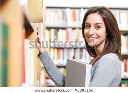 Student in a library choosing a book