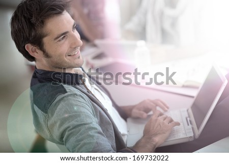 Student in campus relaxing with laptop  - stock photo