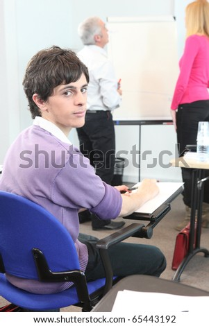 Student in classroom - stock photo