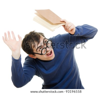 Student in glasses with a book over his head on white background - stock photo