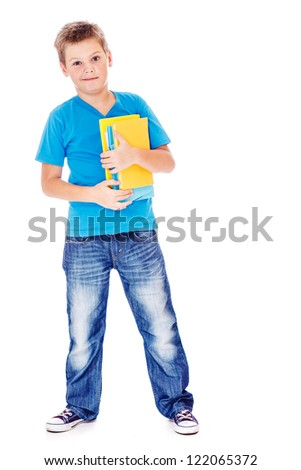 Student in jeans and blue t-shirt, holding books - stock photo