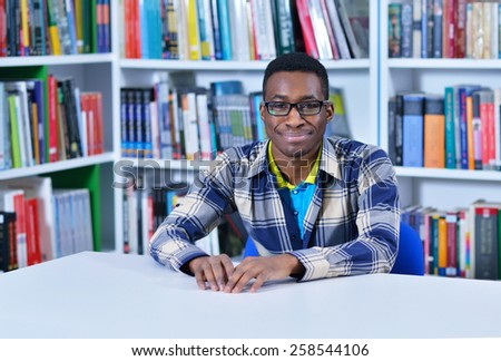 student learning in the library - stock photo